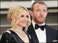 Madonna gives Guy £50m in divorce