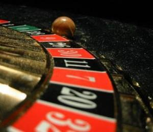 Gambling addict 'drove over wife'