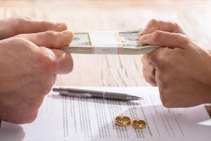 couple-fighting-over-money-over-divorce-papers
